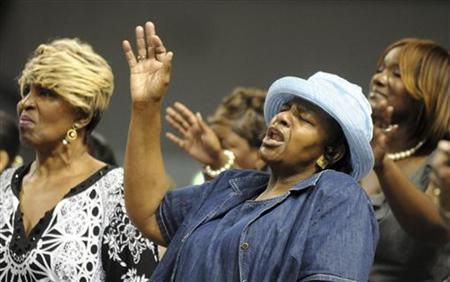 Bethel Baptist Church of Pratt City church members Rosilind Brown (L) and Paulette Williams pray during a service held at Fair Park Arena due to their church being destroyed in Birmingham, Alabama, May 1, 2011. REUTERS/Tami Chappell