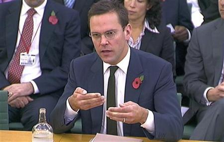 News Corp executive James Murdoch speaks to a parliamentarians in London November 10, 2011. REUTERS/Parbul TV via Reuters TV