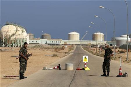 Armed National Transitional Council (NTC) fighters stand at a checkpoint at the Libyan Oil Refining Company (LERCO) in Ras Lanuf, about 660 km (410 miles) west of Tripoli, November 5, 2011. REUTERS/Youssef Boudlal