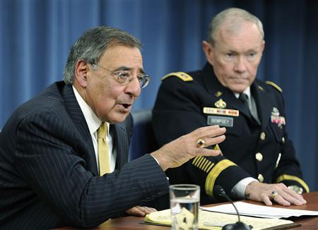 Defense Secretary Leon Panetta (L) and Chairman of the Joint Chiefs of Staff U.S. Army General Martin Dempsey (R) respond to questions during a news conference at the Pentagon in Washington, November 10, 2011. REUTERS/Jonathan Ernst