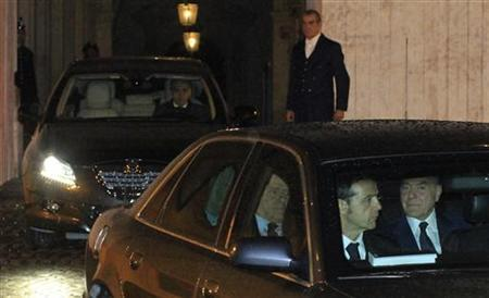 Italy's Prime Minister Silvio Berlusconi (C) leaves the Quirinale Palace after a meeting with Italy's President Giorgio Napolitano in Rome November 8, 2011.  REUTERS/Stringer