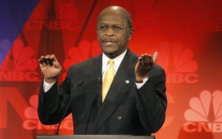 Republican presidential candidate, businessman Herman Cain, speaks at the CNBC Republican presidential debate in Rochester, Michigan, November 9, 2011. REUTERS/Mark Blinch