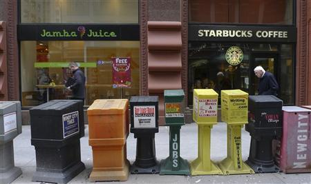 A Starbucks coffee shop and Jamba Juice restaurant stand side by side in Chicago November 10, 2011. REUTERS/Bob Strong