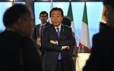 Japan's Prime Minister Yoshihiko Noda waits for the start of a meeting on the second day of the G20 Summit in Cannes November 4, 2011. REUTERS/Dylan Martinez