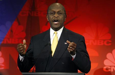 Republican presidential candidate, businessman Herman Cain, gestures as he makes a point at the CNBC Republican presidential debate in Rochester, Michigan, November 9, 2011.   REUTERS/Mark Blinch