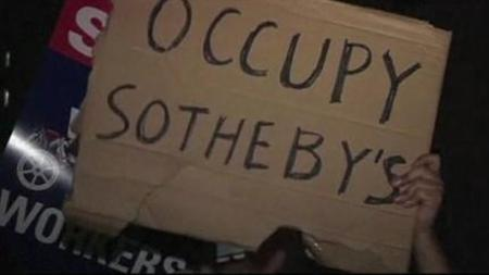 Video screenshot of Occupy Wall Street Protesters gathered outside Sotheby's auction house in New York on November 9, 2011 in a demonstration of solidarity with union art handlers who are locked in a long running labor dispute. REUTERS/TV