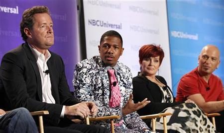 Host Nick Cannon (2nd L) and judges Piers Morgan (L), Sharon Osbourne and Howie Mandel attend the NBC panel for the television show ''America's Got Talent'' during the Television Critics Association summer press tour in Pasadena, California April 15, 2011.  REUTERS/Mario Anzuoni