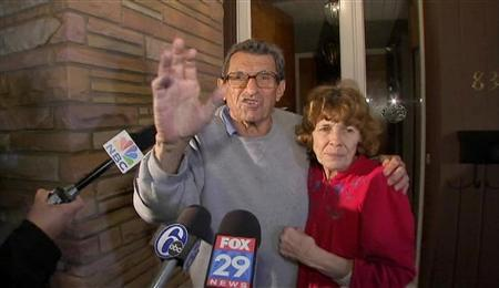 College football coach Joe Paterno (L) and his wife Sue greet supporters outside their home after it was announced that he had been fired by Penn State State University, in this still image taken from video in State College, Pennsylvania November 9, 2011.  REUTERS/Courtesy WCAU-TV NBC Channel 10/Handout