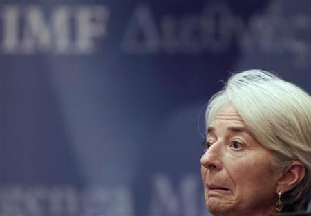 IMF Managing Director Christine Lagarde reacts during a news conference in Beijing November 10, 2011. The head of the International Monetary Fund called on Thursday for political clarity in efforts to tackle the debt crisis that has gripped Italy, saying uncertainty around who would succeed Prime Minister Silvio Berlusconi was fuelling market volatility. REUTERS/Petar Kujundzic