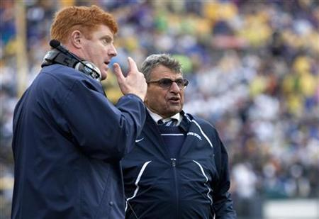 Penn State head coach Joe Paterno (R) talks with assistant coach Mike McQueary during the fourth quarter of the Capital One Bowl NCAA football game against Louisiana State University  in Orlando, Florida January 1, 2010. REUTERS/Scott Audette