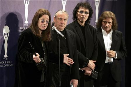 Members of Black Sabbath band Ozzy Osbourne, Bill Ward, Tony Iommi and Geezer Butler (L-R) pose backstage at the Rock and Roll Hall of Fame induction ceremony at the Waldorf Astoria Hotel in New York March 13, 2006.  REUTERS/Brendan McDermid