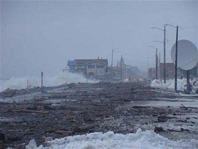 Waves crash against the seawall in Nome, Alaska in this undated recent photograph released to Reuters November 11, 2011 by Alaska's state Division of Homeland Security and Emergency Management. REUTERS/Courtesy Alaska State Troopers/Handout