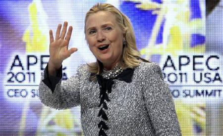 U.S. Secretary of State Hillary Clinton waves after speaking during the APEC CEO summit in Honolulu, Hawaii November 11, 2011. REUTERS/Chris Wattie