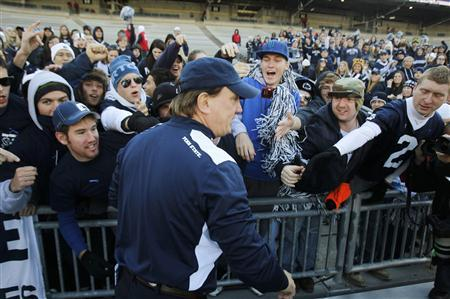 Penn State interim head coach Tom Bradley (C) greets fans prior to their NCAA football game against Nebraska in State College, Pennsylvania November 12, 2011. REUTERS/Tim Shaffer