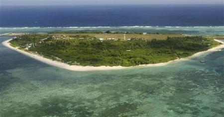 An aerial view shows the Pagasa (Hope) Island, part of the disputed Spratly group of islands, in the South China Sea located off the coast of western Philippines July 20, 2011. REUTERS/Rolex Dela Pena/Pool