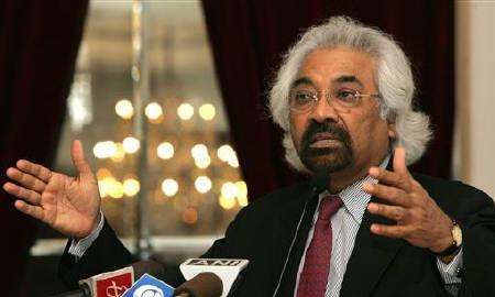 Sam Pitroda gestures while addressing a gathering of software programmers in New Delhi May 10, 2006. REUTERS/Kamal Kishore/Files