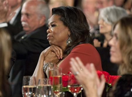 Jean Hersholt Humanitarian Award recipient Oprah Winfrey (C) attends the Academy of Motion Picture Arts & Sciences' 2011 Governors Awards in Hollywood, California, in this publicity handout photograph November 12, 2011. REUTERS/A.M.P.A.S./Matt Petit/Handout