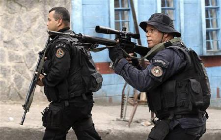 Policemen patrol the Rocinha slum during the ''Shock of Peace'' operation to install Peacekeeping Unit (UPP) in Rio de Janeiro November 13, 2011. REUTERS/Sergio Moraes