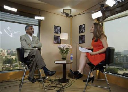 Rajiv Lall (L), Managing Director and CEO of India's Infrastructure Development Finance Company (IDFC) speaks during an interview with Chrystia Freeland, Editor of Thomson Reuters Digital, on the sidelines of the World Economic Forum (WEF) India Economic Summit in Mumbai November 13, 2011. REUTERS/Vivek Prakash