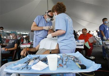 A man receives dental work during the Remote Area Medical (RAM) health clinic at the Wise County Fairgrounds in Wise, Virginia July 24, 2009. REUTERS/Shannon Stapleton
