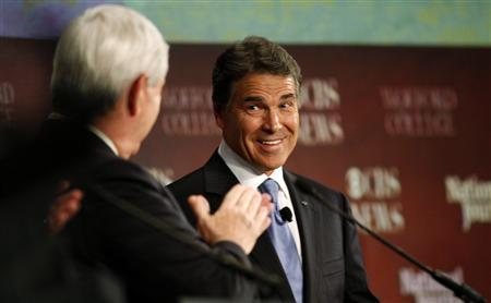 Republican presidential candidate Texas Governor Rick Perry looks toward former U.S. House of Representatives Speaker Newt Gingrich as he answers a question during a South Carolina Republican party presidential debate in Spartanburg, South Carolina November 12, 2011. REUTERS/Chris Keane