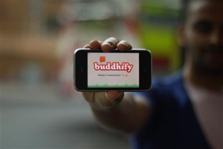 Rohan Gunatillake displays his new Buddhify app, in an undated photo. REUTERS/Handout