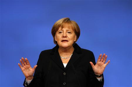 German Chancellor and leader of Germany's conservative Christian Democratic Union (CDU), Angela Merkel gives an opening statement at the party convention at the fairground in Leipzig, November 14, 2011.   REUTERS/Kai Pfaffenbach