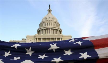 A U.S. Flag is displayed in front of the U.S. Capitol in Washington, November 2, 2010.  REUTERS/Molly Riley/Files