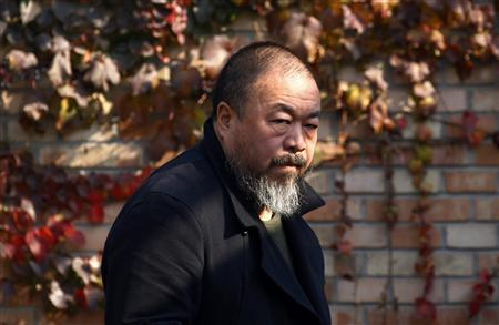 Dissident Chinese artist Ai Weiwei walks to the door of his home after talking to his lawyers in Beijing November 14, 2011.    REUTERS/David Gray