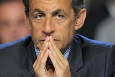 France's President Nicolas Sarkozy attends a meeting with timber industry members in Egletons, central France, April 28, 2011.  REUTERS/Philippe Wojazer