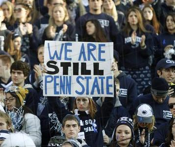 Penn State football fans look on after their loss in an NCAA football game against Nebraska in State College, Pennsylvania November 12, 2011. Penn State's football team struggled in its final home football game of the year on Saturday after its revered coach was fired amid a child sex abuse and cover-up scandal that has rocked the campus.    REUTERS/Tim Shaffer