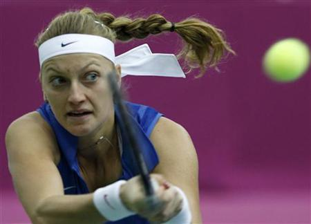 The Czech Republic's Petra Kvitova hits a return against Russia's Svetlana Kuznetsova during their Fed Cup World Group final tennis match in Moscow November 6, 2011. REUTERS/Grigory Dukor