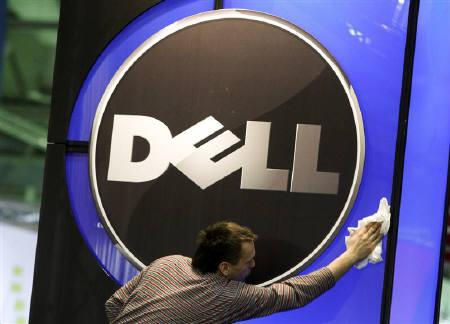 A man wipes the logo of the Dell IT firm at the CeBIT exhibition centre in Hannover February 28, 2010. REUTERS/Thomas Peter/Files