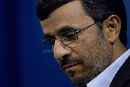 Iranian President Mahmoud Ahmadinejad checks his notes during a news conference in Tehran June 7, 2011. REUTERS/Caren Firouz/Files