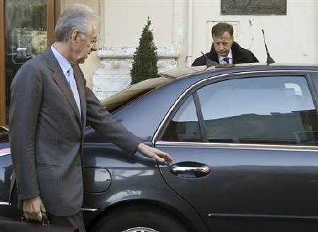 Mario Monti leaves a hotel in Rome November 12, 2011. REUTERS/Stringer/Files