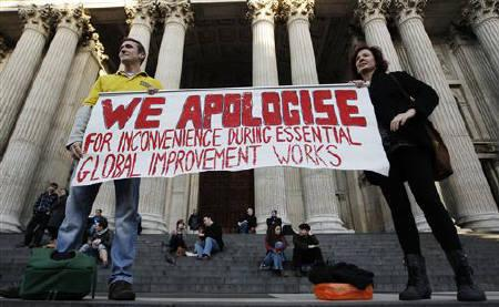 Protesters hold up a banner at the Occupy London Stock Exchange protest camp on the steps of St Paul's Cathedral, in the City of London, November 1, 2011. REUTERS/Andrew Winning/Files