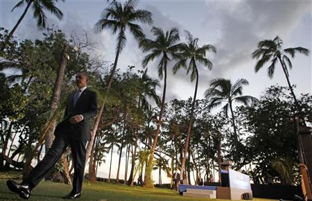 President Obama leaves his news conference at the APEC Summit in Honolulu, Hawaii, November 13, 2011. REUTERS/Jim Young