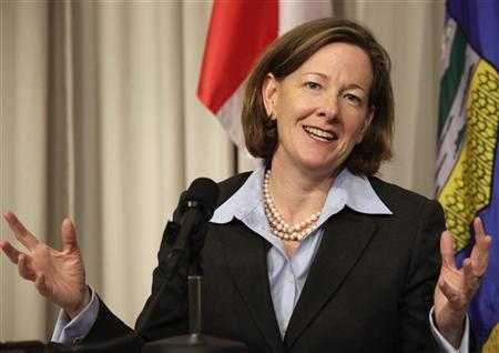 Alberta Premier Alison Redford speaks at a news conference about the Keystone XL pipeline at the Canadian Embassy in Washington November 14, 2011. U.S. President Barack Obama told Canadian Prime Minister Stephen Harper on Sunday that he stood by the decision to delay a verdict on the Keystone XL pipeline, the White House said. REUTERS/Yuri Gripas