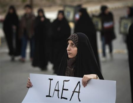 An Iranian student holds a placard as she attends a demonstration, before a ceremony to form a human chain around the Uranium Conversion Facility (UCF), to show her support for Iran's nuclear program in Isfahan, south of Tehran, November 15, 2011. REUTERS/Morteza Nikoubazl