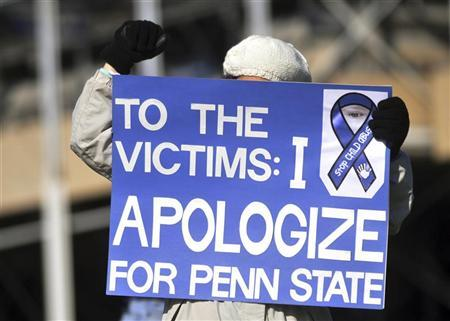 An unidentified protestor stands outside Beaver Stadium prior to the NCAA football game between Nebraska and Penn State in State College, Pennsylvania November 12, 2011.  REUTERS/Pat Little