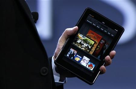 Amazon CEO Jeff Bezos holds up the new Kindle Fire at a news conference during the launch of Amazon's new tablets in New York, September 28, 2011. REUTERS/Shannon Stapleton
