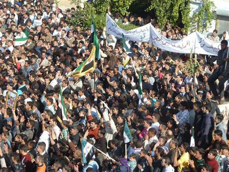 Demonstrators protest against Syria's President Bashar al-Assad gather in Hula, near Homs November 13, 2011. REUTERS/Handout