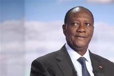 Ivory Coast President Alassane Ouattara appears on the French TF1 television prime time evening news show September 13, 2011 in Paris.   REUTERS/Fred Dufour/Pool