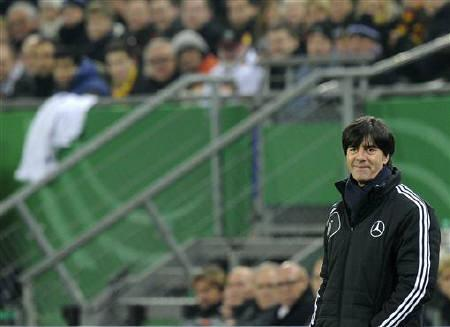 Germany's head coach Joachim Loew smiles during their friendly soccer match against the Netherlands in Hamburg, November 15, 2011.  REUTERS/Fabian Bimmer