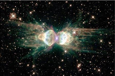 From ground-based telescopes, this cosmic object - the glowing remains of a dying, sun-like star - resembles the head and thorax of a garden-variety ant. This NASA/ESA Hubble Space Telescope image, released on February 1, 2001, of the so-called ''ant nebula'' (Menzel 3, or Mz3) shows even more detail, revealing the ''ant's'' body as a pair of fiery lobes protruding from the dying star. REUTERS/NASA