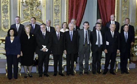 Italian Prime Minister Mario Monti (5th L) and President Giorgio Napolitano (4th L) pose with new ministers at the Quirinale Palace in Rome November 16, 2011. REUTERS/Remo Casilli