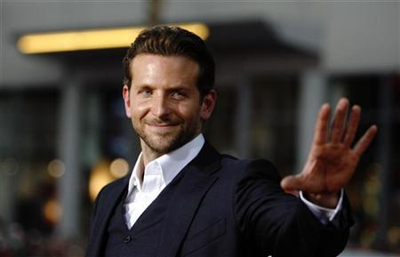 Cast member Bradley Cooper waves at the premiere of the movie ''All About Steve'' at the Mann Chinese theatre in Hollywood, California August 26, 2009. REUTERS/Mario Anzuoni