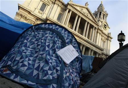 An eviction notice from the City of London hangs on a tent outside St. Paul's Cathedral in London November 16, 2011. REUTERS/Suzanne Plunkett