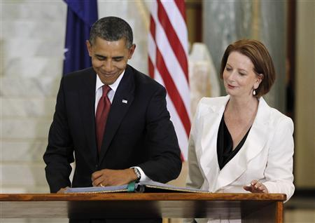President Barack Obama signs a guest book after participating in an arrival ceremony with Australia's Prime Minister Julia Gillard at Parliament House in Canberra, Australia, November 16, 2011.  REUTERS/Jason Reed