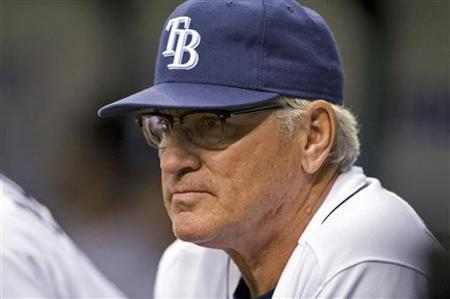 Tampa Bay Rays manager Joe Maddon watches his team play the Chicago White Sox during the fourth inning of their American League MLB baseball game in St. Petersburg, Florida, April 19, 2011.  REUTERS/Steve Nesius